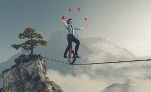 unicycle peddling across a rope